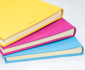 Real leather photo albums in a range of bright modern colours